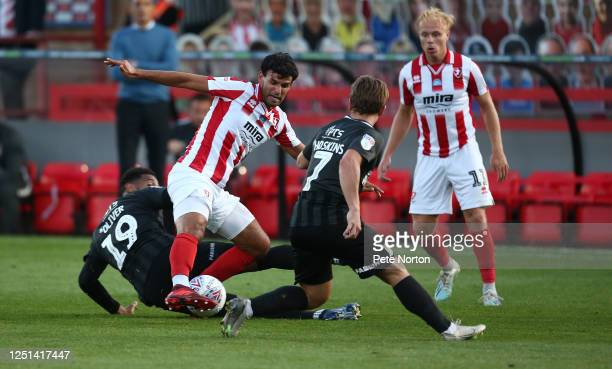 Conor Thomas of Cheltenham Town attempts to control the ball under pressure from Vadaine Oliver during the Sky Bet League Two Play Off Semifinal 2nd...