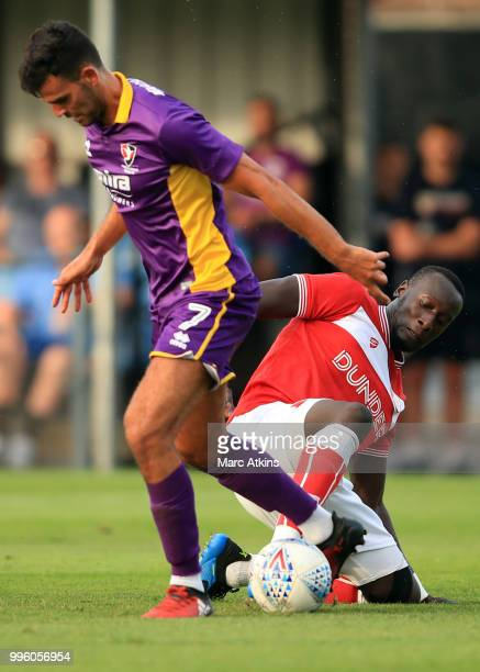 Conor Thomas of Cheltenham Town in action with Famara Diedhiou of Bristol City during the PreSeason Friendly between Bristol City v Cheltenham Town...