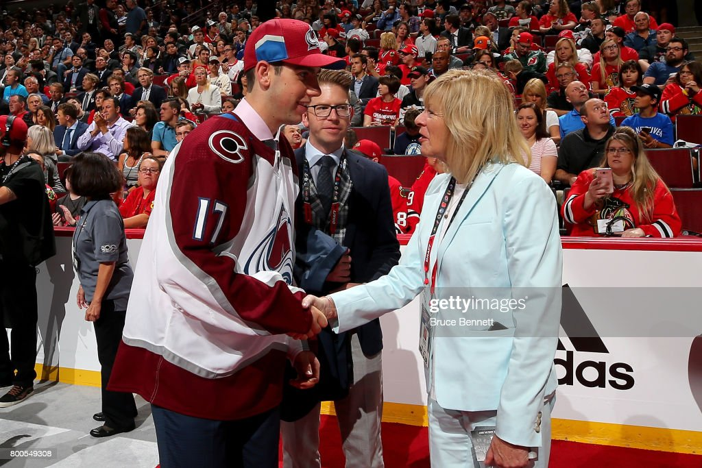 Conor Timmins meets with executives after being selected 32nd overall by the Colorado Avalanche during the 2017 NHL Draft at the United Center on June 24, 2017 in Chicago, Illinois.
