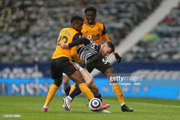 Conor Townsend of West Bromwich Albion gets between Nelson Semedo of Wolverhampton Wanderers and Owen Otasowie of Wolverhampton Wanderers during the...