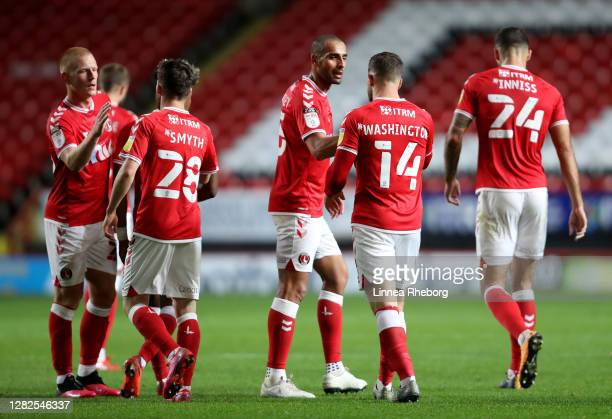 Conor Washington of Charlton Athletic celebrates with his team after scoring his sides first goal during the Sky Bet League One match between...