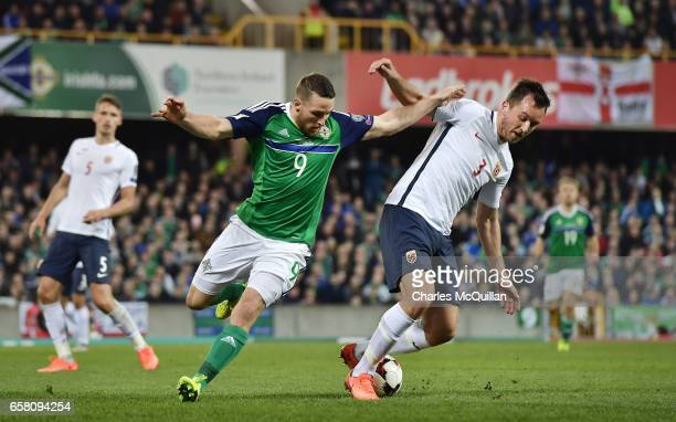Conor Washington of Northern Ireland and Even Hovland of Norway during the FIFA 2018 World Cup Qualifier between Northern Ireland and Norway at...