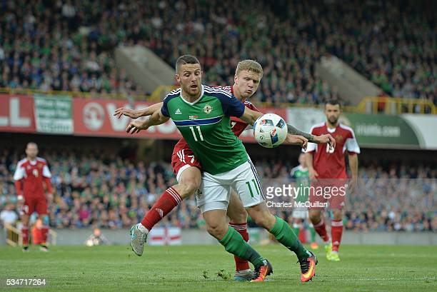 Conor Washington of Northern Ireland and Mikita Korzun of Belarus during the international friendly game between Northern Ireland and Belarus on May...