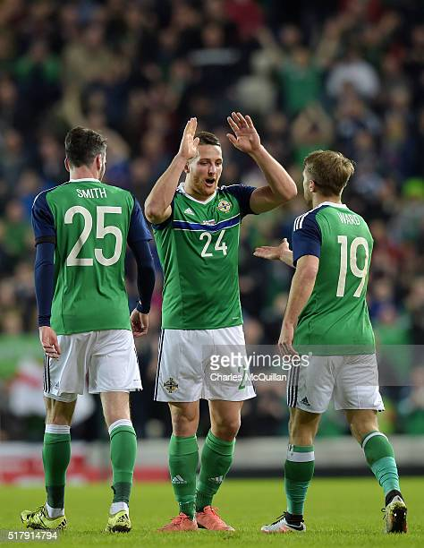 Conor Washington of Northern Ireland celebrates with team mates after scoring during the international friendly between Northern Ireland and Slovenia...