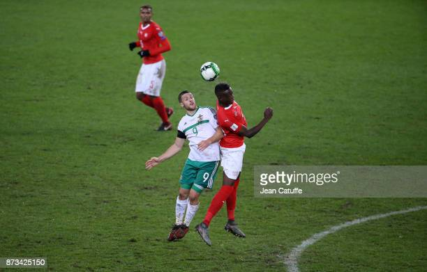 Conor Washington of Northern Ireland Denis Zakaria of Switzerland during the FIFA 2018 World Cup Qualifier PlayOff Second Leg between Switzerland and...