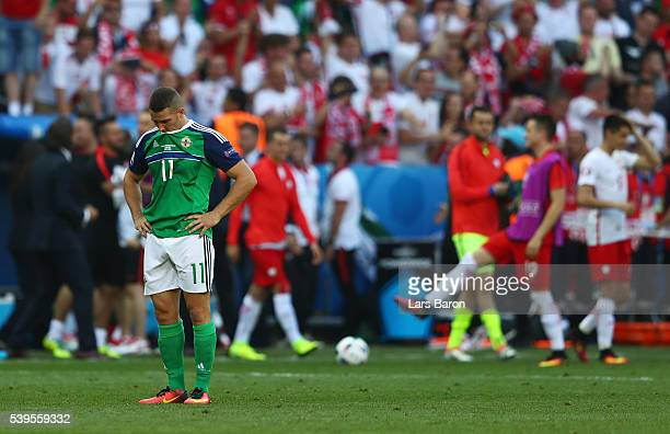 Conor Washington of Northern Ireland show their dejection after his team's 01 defeat in the UEFA EURO 2016 Group C match between Poland and Northern...