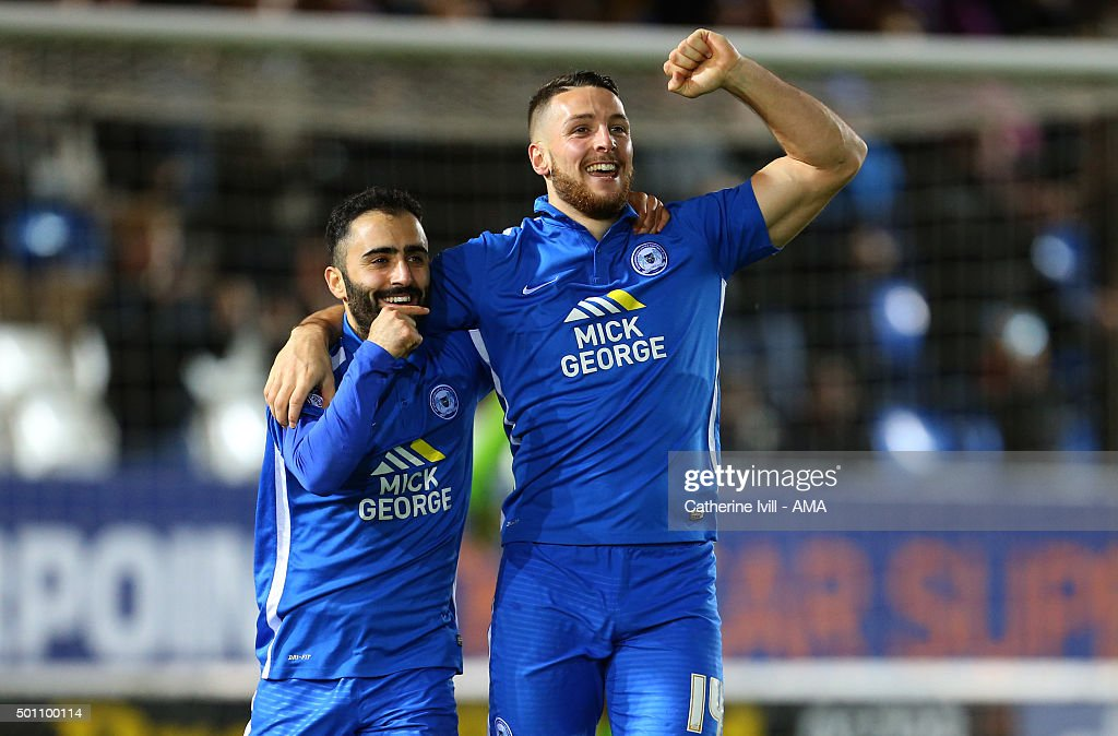 Conor Washington of Peterborough United celebrates after he scores a goal to make it 1-0 with Erhun Oztumer of Peterborough United during the Sky Bet League One match between Peterborough United and Shrewsbury Town at London Road Stadium on December 12, 2015 in Peterborough, England.