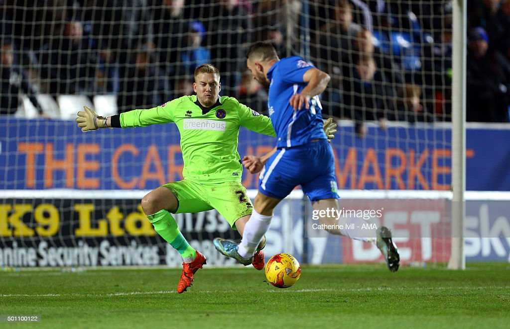 Conor Washington of Peterborough United scores a goal past Mark Halstead of Shrewsbury Town to make it 1-0 during the Sky Bet League One match between Peterborough United and Shrewsbury Town at London Road Stadium on December 12, 2015 in Peterborough, England.