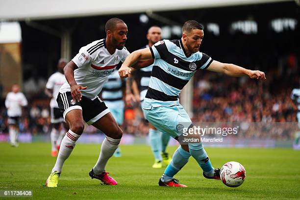 Conor Washington of QPR tackles with Denis Odoi of Fulham during the Sky Bet Championship match between Fulham and Queens Park Rangers at Craven...