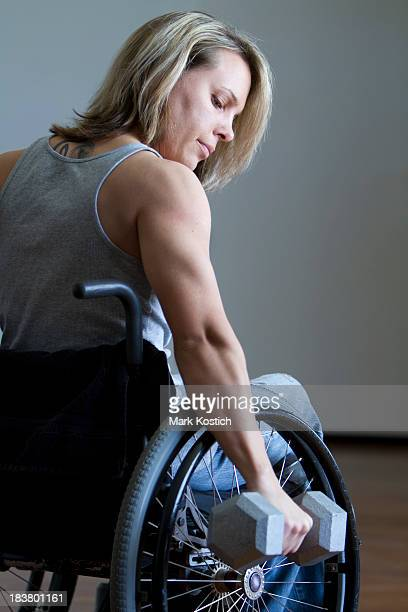 conquering adversity - woman in wheelchair working out - paraplegic stock photos and pictures