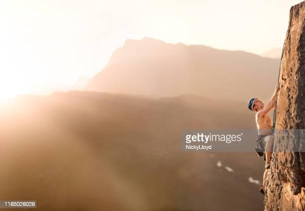conquering the cliff - nicky pende foto e immagini stock