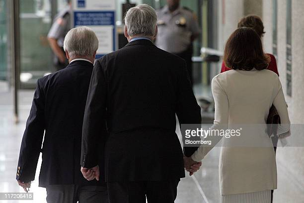 Conrad Black former chairman of Hollinger International Inc center arrives with his wife Barbara Amiel right at the Dirksen Federal Courthouse for a...