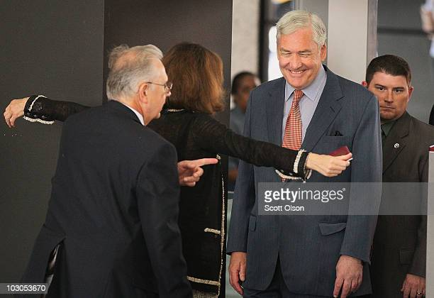 Conrad Black watches as his wife Barbara Amiel is checked after arriving at the Dirksen Federal Building to hear the terms of his bail July 23 2010...