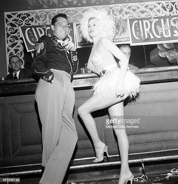 Conrad Hilton Jr with guest attends Sonja Henie Circus party in Los Angeles California