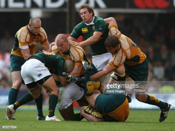 Conrad Jantes of South Africa is tackled by Stephen Moore during the 2008 Tri Nations between the South Africa Springboks and the Australian...