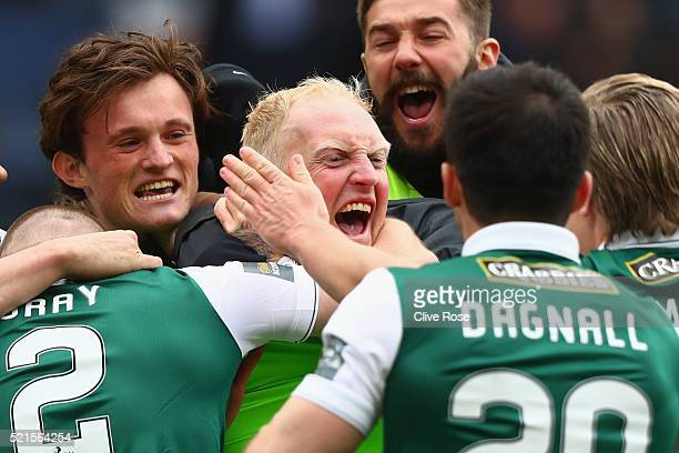 Conrad Logan of Hibernian is mobbed by teammates as Hibernian win the Scottish Cup Semi Final between Hibernian and Dundee United after his two...