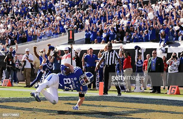 J Conrad of the Kentucky Wildcats catches the ball in the end zone for a twopoint conversion during the fourth quarter of the game against the...