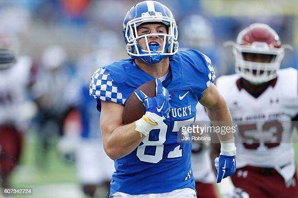 J Conrad of the Kentucky Wildcats runs after a reception for a 72yard touchdown in the first quarter against the New Mexico State Aggies at...
