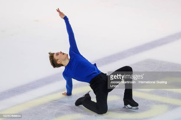 Conrad Orzel of Canada competes in the Junior Men Short Program during day one of the ISU Junior Grand Prix of Figure Skating at Keine Sorgen Eis...