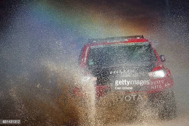 Conrad Rautenbach of Zimbabwe and Imperial Toyota drives with Robert Howie of South Africa in the Toyota car in the Classe T13 2 Roues Motrices...