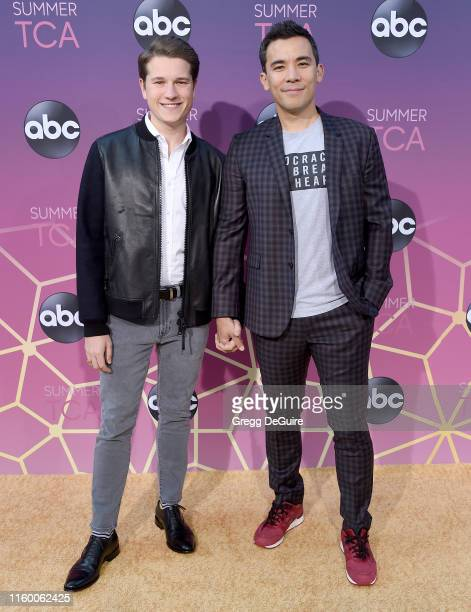 Conrad Ricamora and Josh Cockream arrive at ABC's TCA Summer Press Tour Carpet Event on August 5 2019 in West Hollywood California