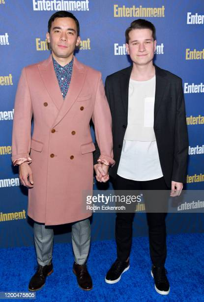 Conrad Ricamora and Joshua Cockream attend Entertainment Weekly PreSAG Celebration at Chateau Marmont on January 18 2020 in Los Angeles California