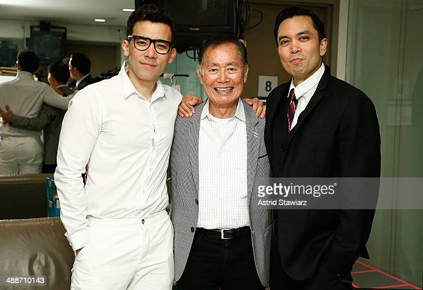 Conrad Ricamora George Takei and Jose Llana pose for photos after a showing of Here Lies Love at The Public Theater on May 7 2014 in New York City