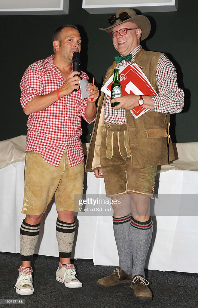 Conrad Seidl (R) aka Bierpapst speaks to the audience during the beauty competition 'Miss Wiener Wiesn-Fest 2014' at Platzhirsch on on June 12, 2014 in Vienna, Austria.