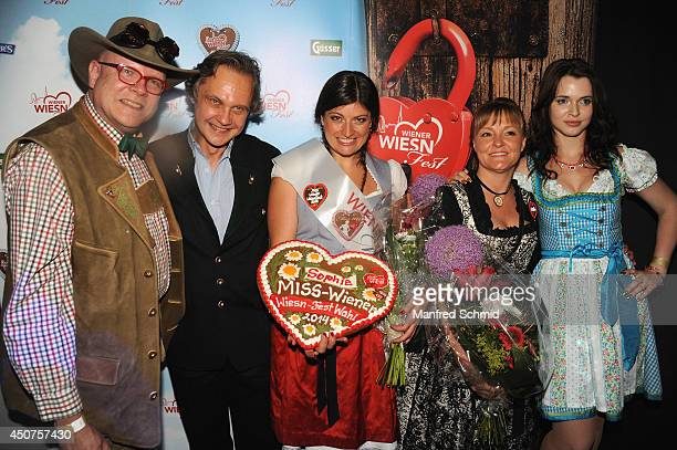 Conrad Seidl Christian Feldhofer Sophie Marie Claudia Wiesner and Roxanne Rapp pose for a photograph during the beauty competition 'Miss Wiener...