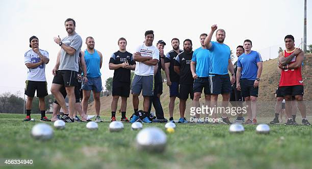 Conrad Smith celebrates after getting a ball close during a game of Pétanque during the New Zealand All Blacks activities session held at Hyde Park...