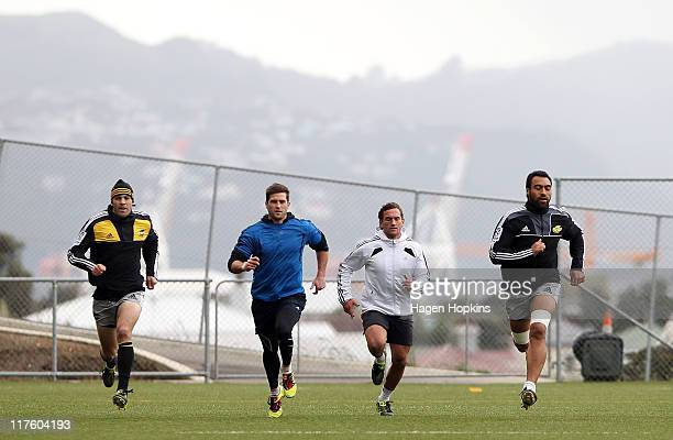 Conrad Smith Cory Jane Aaron Cruden and Victor Vito warm up during a New Zealand All Blacks training session at Rugby League Park on June 29 2011 in...
