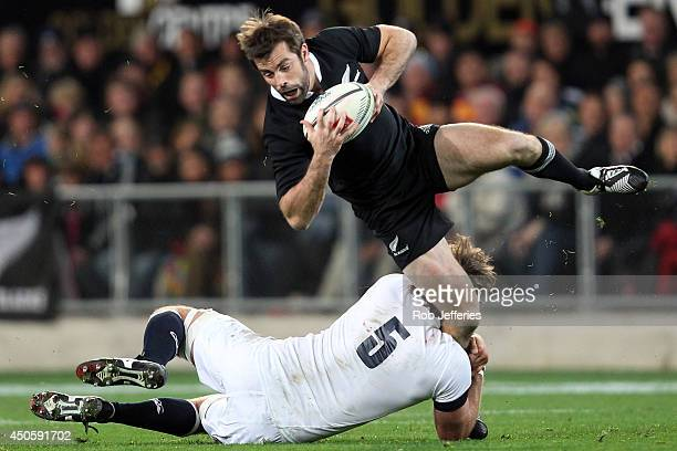 Conrad Smith of New Zealand is tackled by Geoff Parling of England during the International Test Match between the New Zealand All Blacks and England...