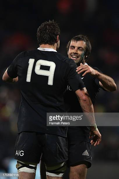Conrad Smith of the All Blacks celebrates with Jeremy Thrush of the All Blacks after winning the International Test match between the New Zealand All...