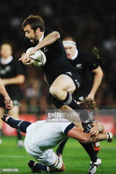 Conrad Smith of the All Blacks charges forward during the International Test Match between the New Zealand All Blacks and England at Forsyth Barr...
