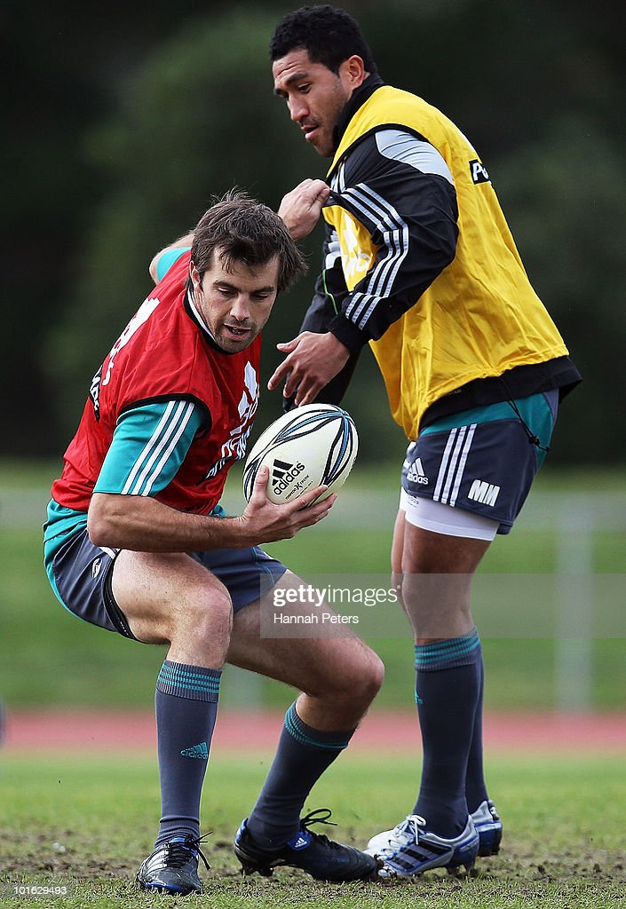 Conrad Smith of the All Blacks fends off Mils Muliaina during a New Zealand All Blacks training session at Trusts Stadium on June 5, 2010 in Auckland, New Zealand.
