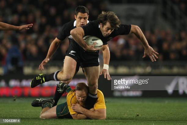 Conrad Smith of the All Blacks is tackled by Stephen Moore of the Wallabies during the Tri-Nations match between the New Zealand All Blacks and the...