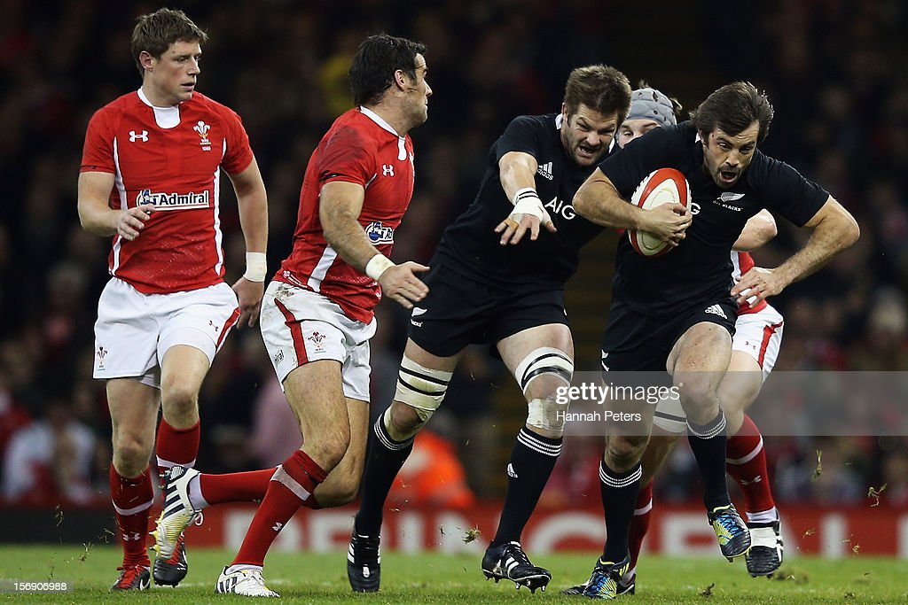 Conrad Smith of the All Blacks makes a break during the international match between Wales and New Zealand at Millennium Stadium on November 24, 2012 in Cardiff, Wales.