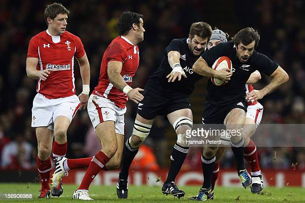 Conrad Smith of the All Blacks makes a break during the international match between Wales and New Zealand at Millennium Stadium on November 24 2012...
