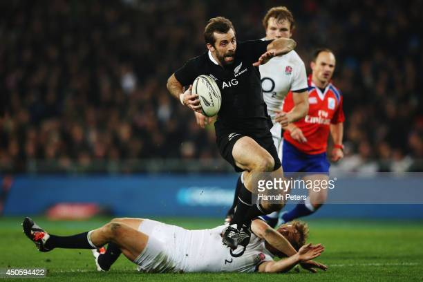 Conrad Smith of the All Blacks makes a break during the International Test Match between the New Zealand All Blacks and England at Forsyth Barr...