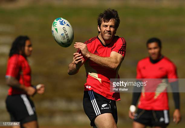 Conrad Smith of the All Blacks passes during a New Zealand All Blacks IRB Rugby World Cup 2011 training session at Rugby League Park on September 27,...