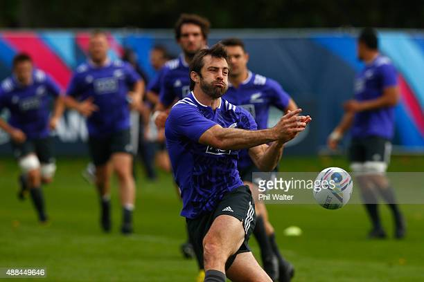 Conrad Smith of the All Blacks passes during a New Zealand All Blacks training session at Lensbury on September 16, 2015 in London, United Kingdom.
