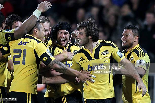 Conrad Smith of the Hurricanes celebrates with his team mates after the round 16 Super Rugby match between the Crusaders and the Hurricanes at AMI...