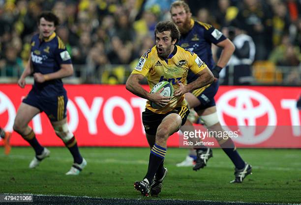 Conrad Smith of the Hurricanes on the attack during the Super Rugby Final match between the Hurricanes and the Highlanders at Westpac Stadium on July...