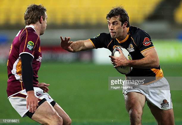 Conrad Smith of Wellington fends Matt Saunders of Southland during the round eleven ITM Cup match between Wellington and Southland at Westpac Stadium...