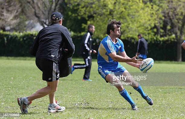 Conrad Smith passes the ball during a New Zealand All Blacks training session held at St George's College on September 25 2012 in Buenos Aires...