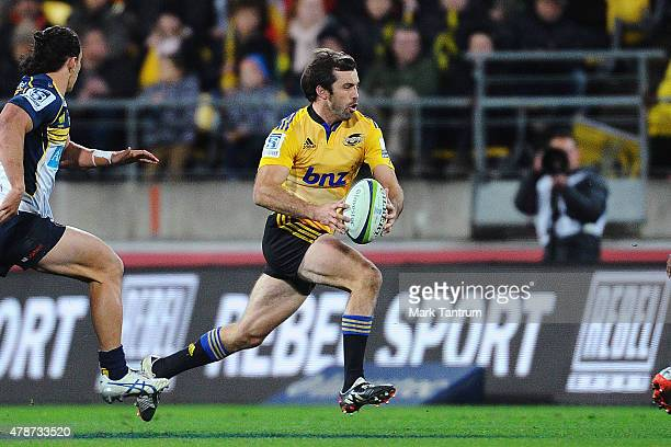 Conrad Smith runs the ball during the Super Rugby Semi Final match between the Hurricanes and the Brumbies at Westpac Stadium on June 27 2015 in...