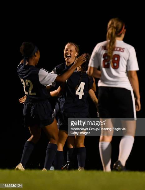 Conrad Weiser's Carissa Hagerty , center, cenebrates her goal with TaCari Talford and Izzy Dalesandro .GIRLS SOCCER Conrad Weiser Scouts defeat the...
