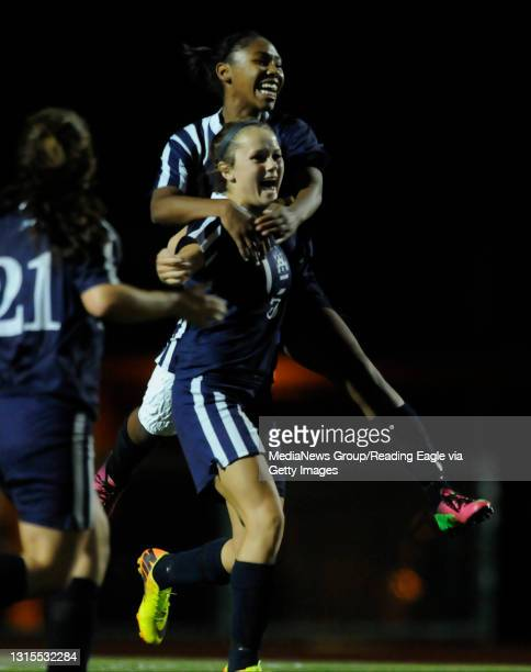 Conrad Weiser's Kennedy Lutz , front, celebrates her second half goal and is jumped on by TaCari Talford .GIRLS SOCCER Conrad Weiser Scouts defeat...