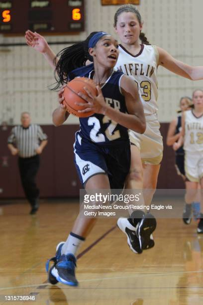 Conrad Weiser's TaCari Talford dribbles the ball up the court with Gov. Mifflin's Jennifer Martin not far behind during the basketball game at Gov....