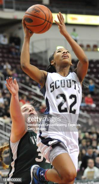 Conrad Weiser's TaCari Talford goes up for two with West Perry's Caitlyn Lavenberg trailing. 2/25/2015 - Photo by Harold Hoch - GIRLS BASKETBALL The...